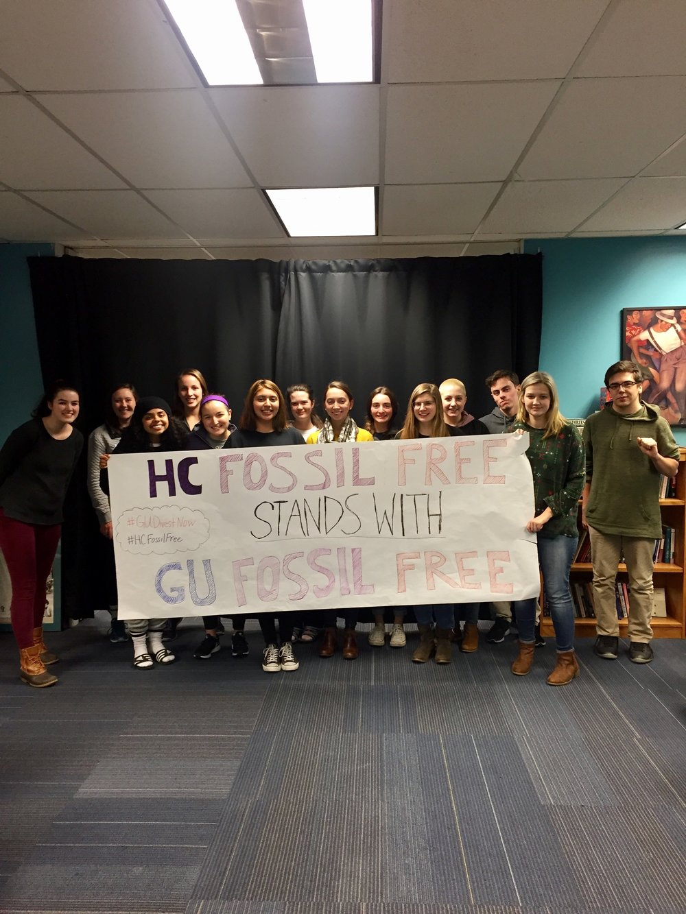 Members of HC Fossil Free, Holy Cross' divestment campaign, take a photo in support of an escalation taken by Georgetown's campaign, GU Fossil Free, this past fall. Jesuit education holds great potential for such cross-campus collaboration on climate justice initiatives.