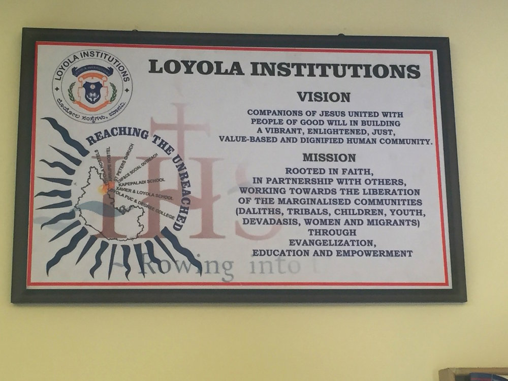 This sign of Loyola Xavier's mission statement hangs in the front hall of the campus' Jesuit residence in Manvi.