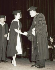 A woman accepting her graduation award, 1956.  All photos courtesy of Saint Louis University Libraries Digital Collections.