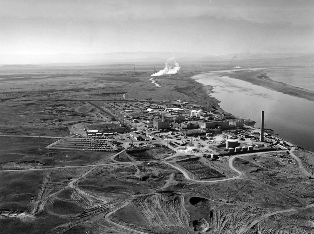 Nuclear reactors line the riverbank at the Hanford Site along the Columbia River (1960).