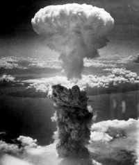 The mushroom cloud from the Nagaskai bomb (1945) highlights the more well-known effects of nuclear devices.