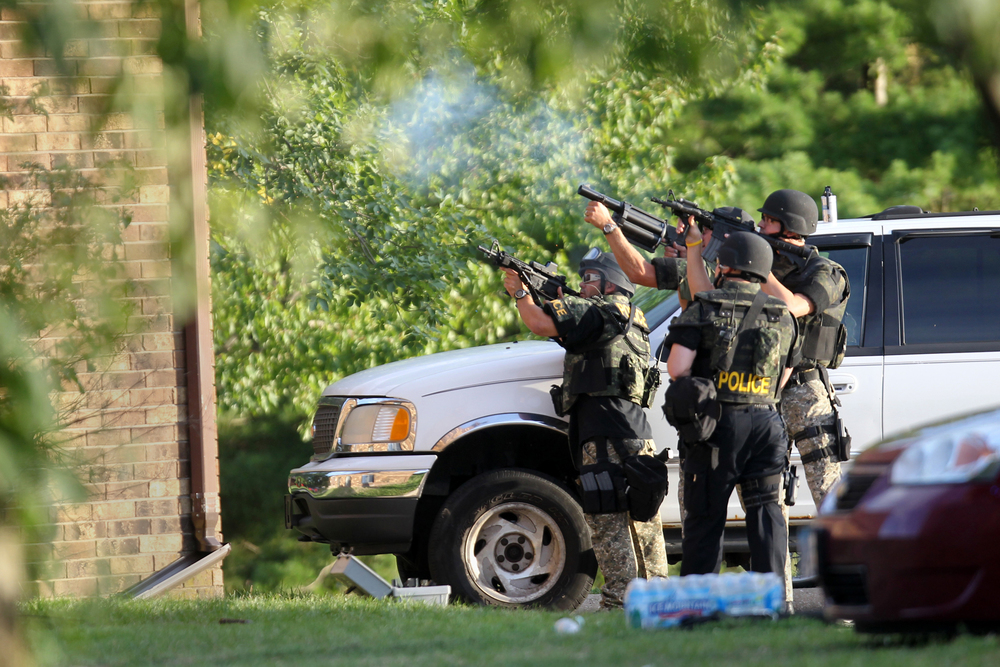 Police officers from Iowa City, Coralville, DCI and state patrol surround 1305 Sunset Street during a 4-hour standoff.