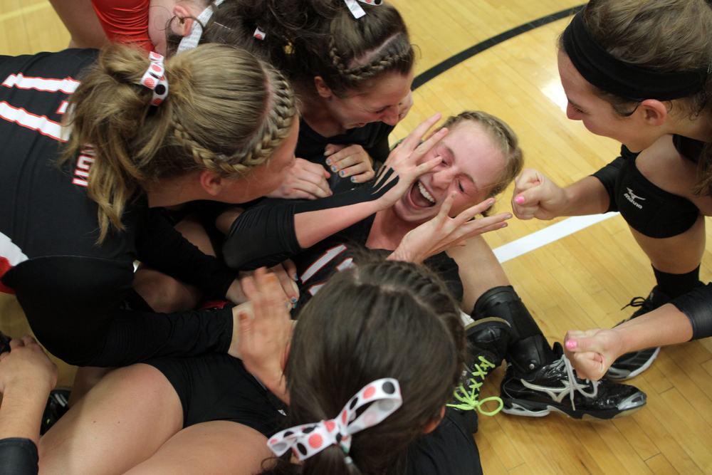 West Branch teammates surround Heather Poula after winning their game against West Liberty.