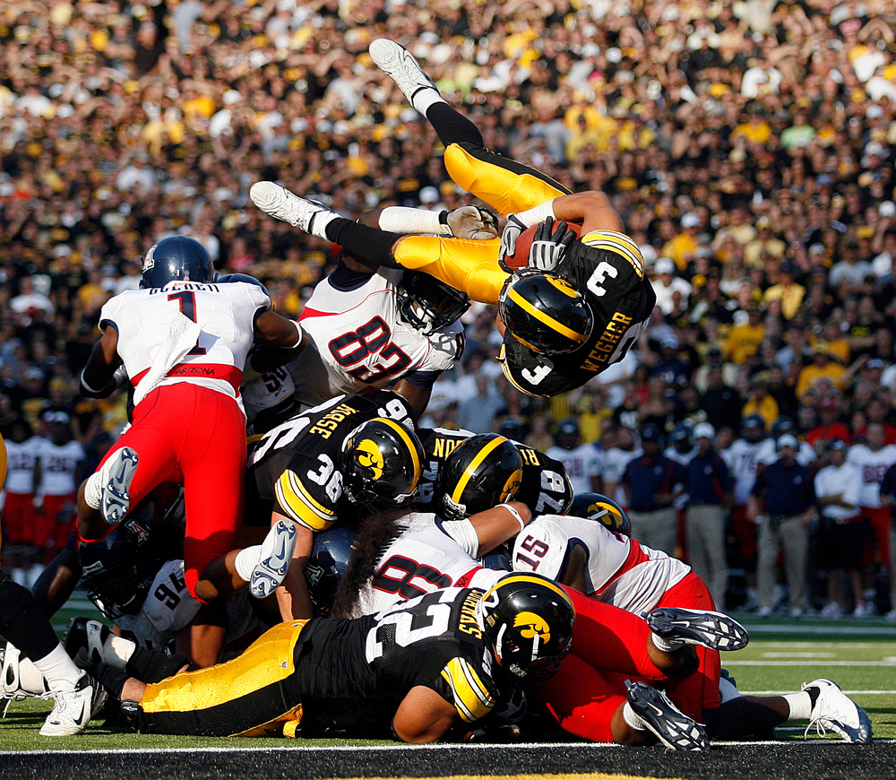 Iowa's Brandon Wegher leaps into the end zone during the Hawkeyes' game against Arizona at Kinnick Stadium.