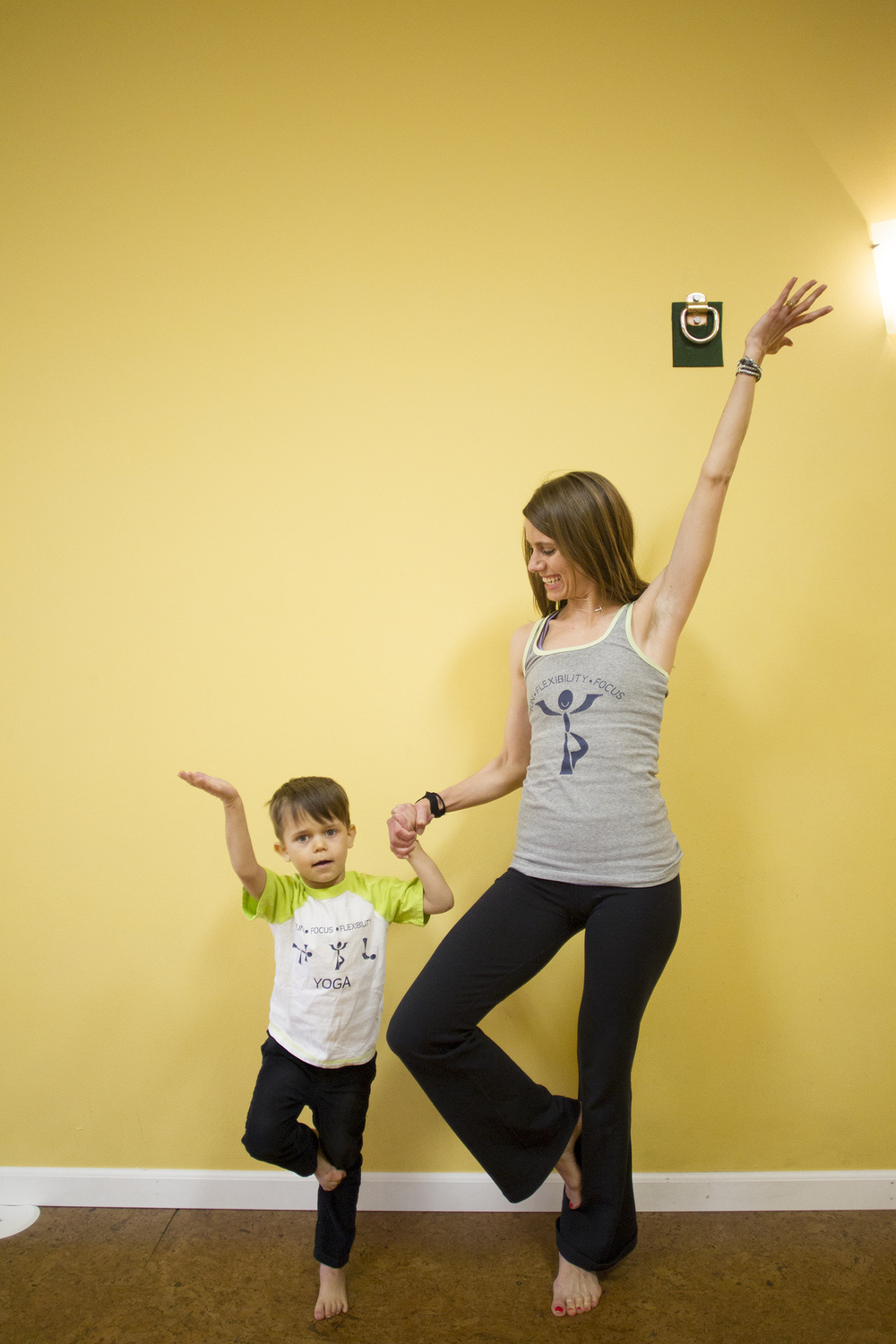 Dana Robinson poses with her son, Tymen, at Sweet Feet Yoga.