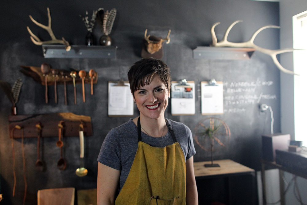 Local welder and furniture-maker Pam Hodnefield poses for a photo in her shop.