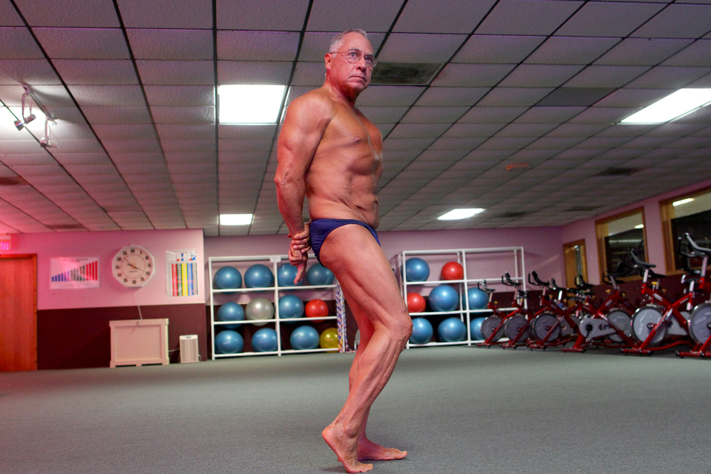 Gilbert Aldape flexes as he goes through a routine at New Life Fitness World on Wednesday, April 11, 2012. The 71-year-old began working out after being diagnosed with diabetes in 2000.