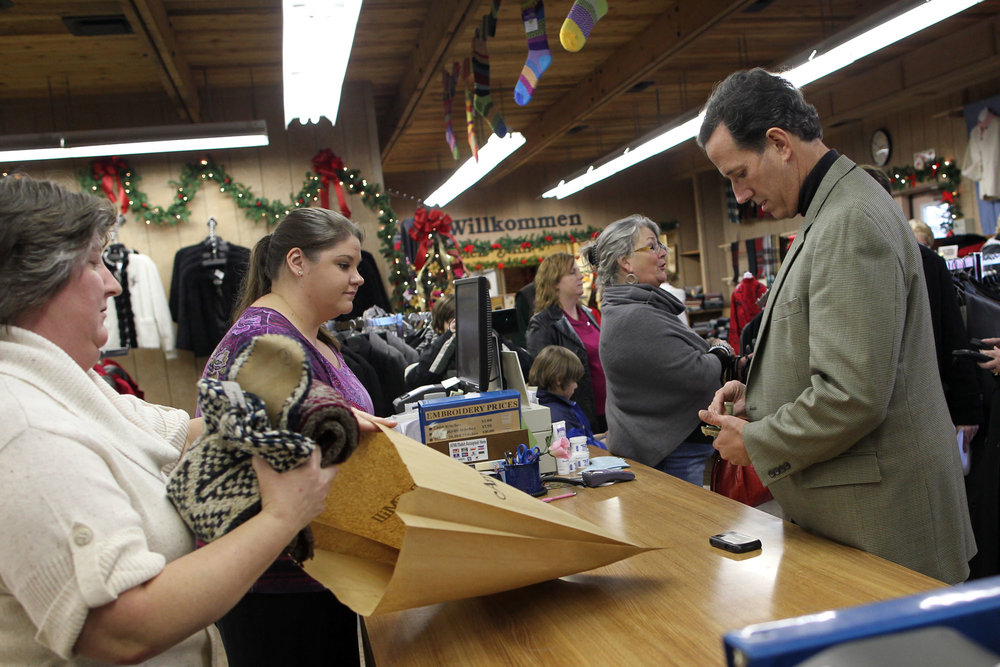 Republican presidential candidate Rick Santorum shops for Christmas gifts for his family in Amana.