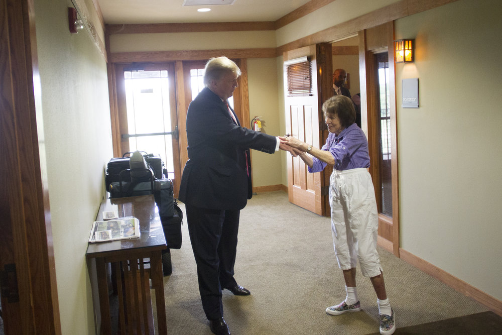 Donald Trump greets a guest at Brown Deer Golf Course, days before announcing his candidacy for President of the United States.