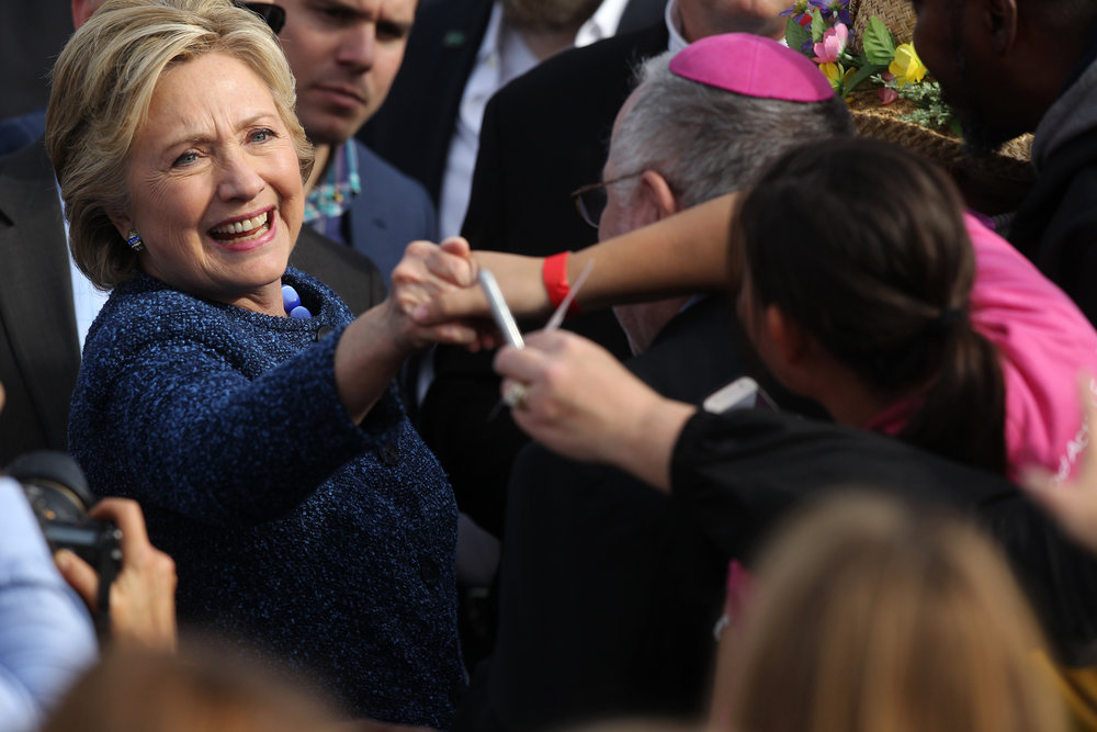 Democratic presidential candidate Hillary Clinton greets guests following her speech outside the NewBo City Market.
