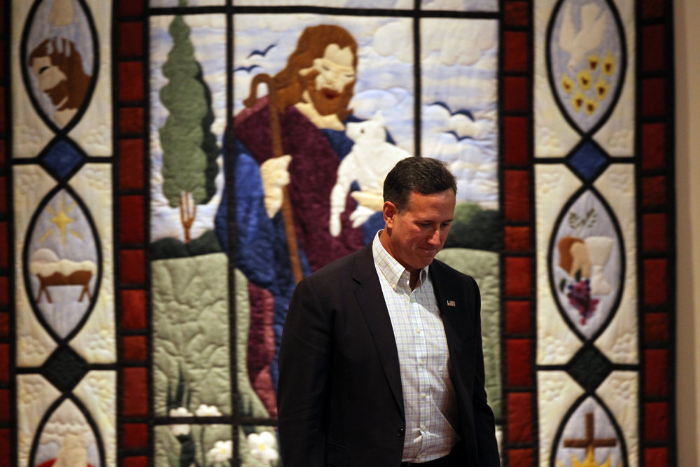 Republican presidential candidate Rick Santorum is introduced at Grace Fellowship Church.