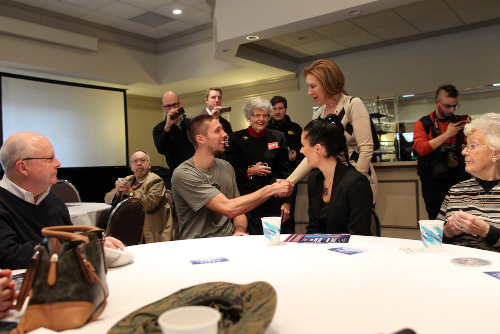 Republican presidential candidate Carly Fiorina greets Iowa basketball star Jarrod Uthoff during a town hall meeting.