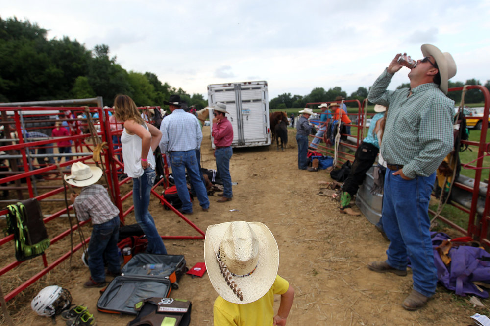 A young boy hangs out near the pens during a rodeo at the Johnson County Fairgrounds.