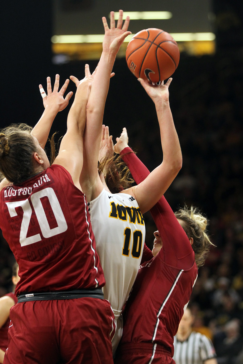 Iowa's Megan Gustafson takes a contested shot during the Hawkeyes' WNIT Elite Eight game against Washington State at Carver-Hawkeyes Arena.
