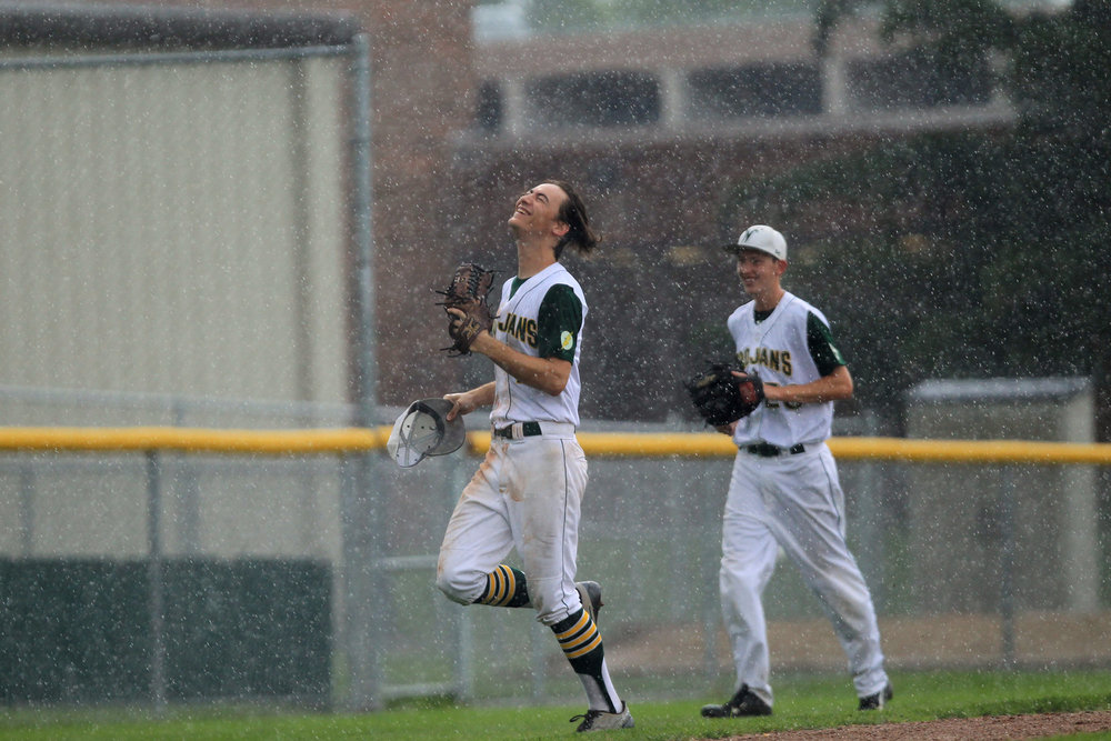 West High's Kevin DeLaney embraces the rain as the Trojans' game against Waterloo East gets postponed until another day.