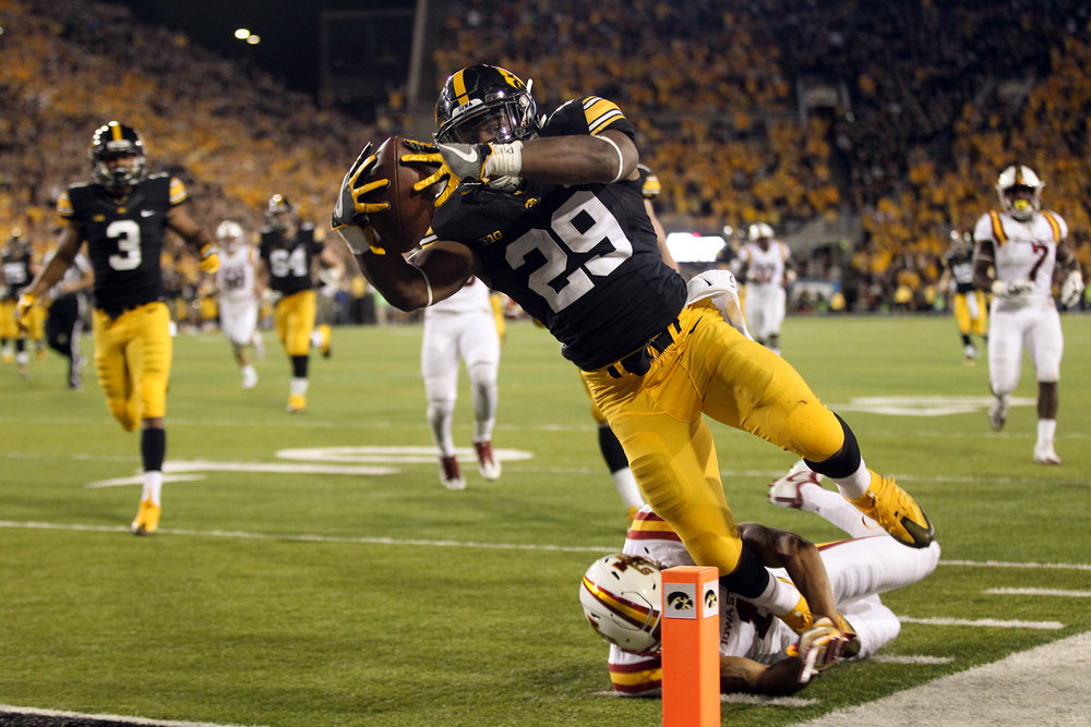 Iowa's LeShun Daniels, Jr. dives in for a touchdown during the Hawkeyes' game against Iowa State at Kinnick Stadium.