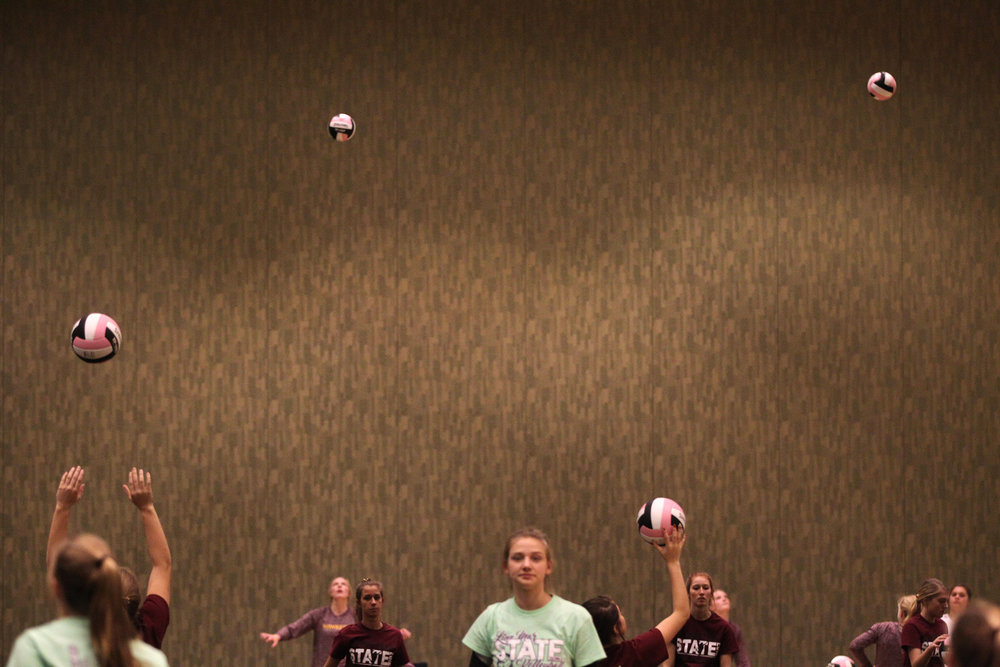 Players warm up for their matches at the Iowa State Volleyball Tournament in Cedar Rapids.