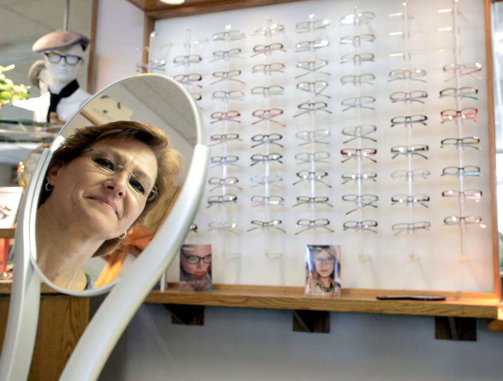Optician Elaine Baily poses for a photo at Klauer Optical on Monday, June 13, 2011.