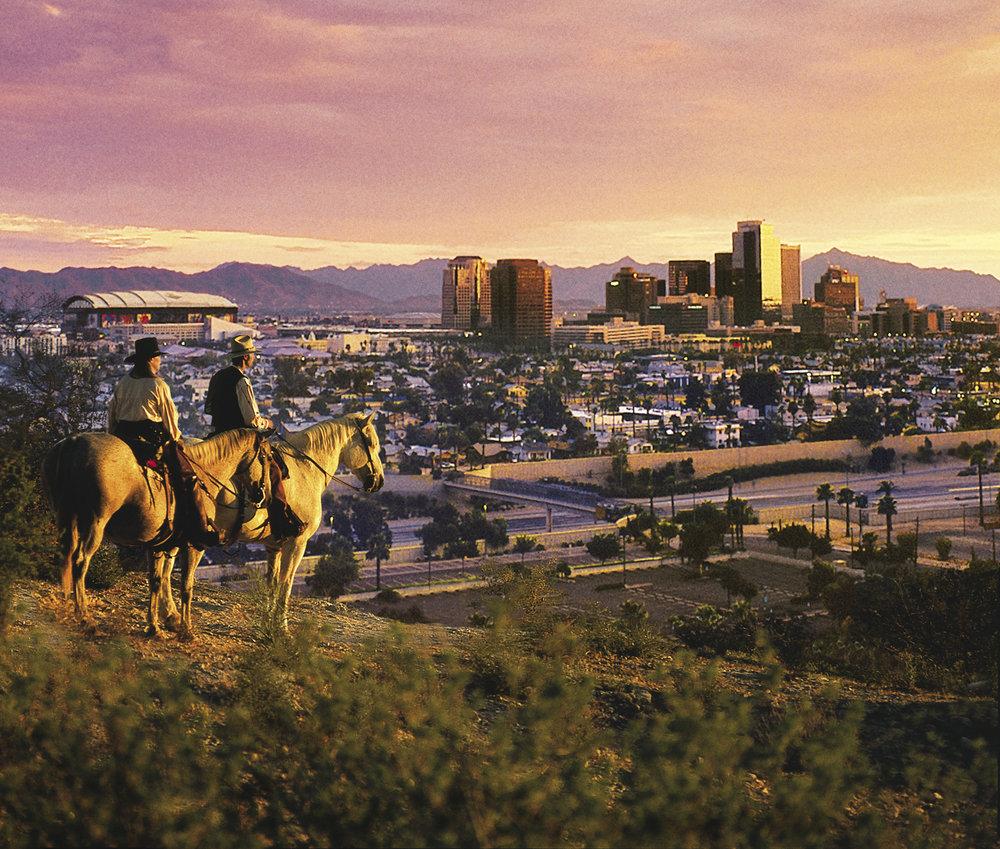 cowboys_overlooking_city.jpg
