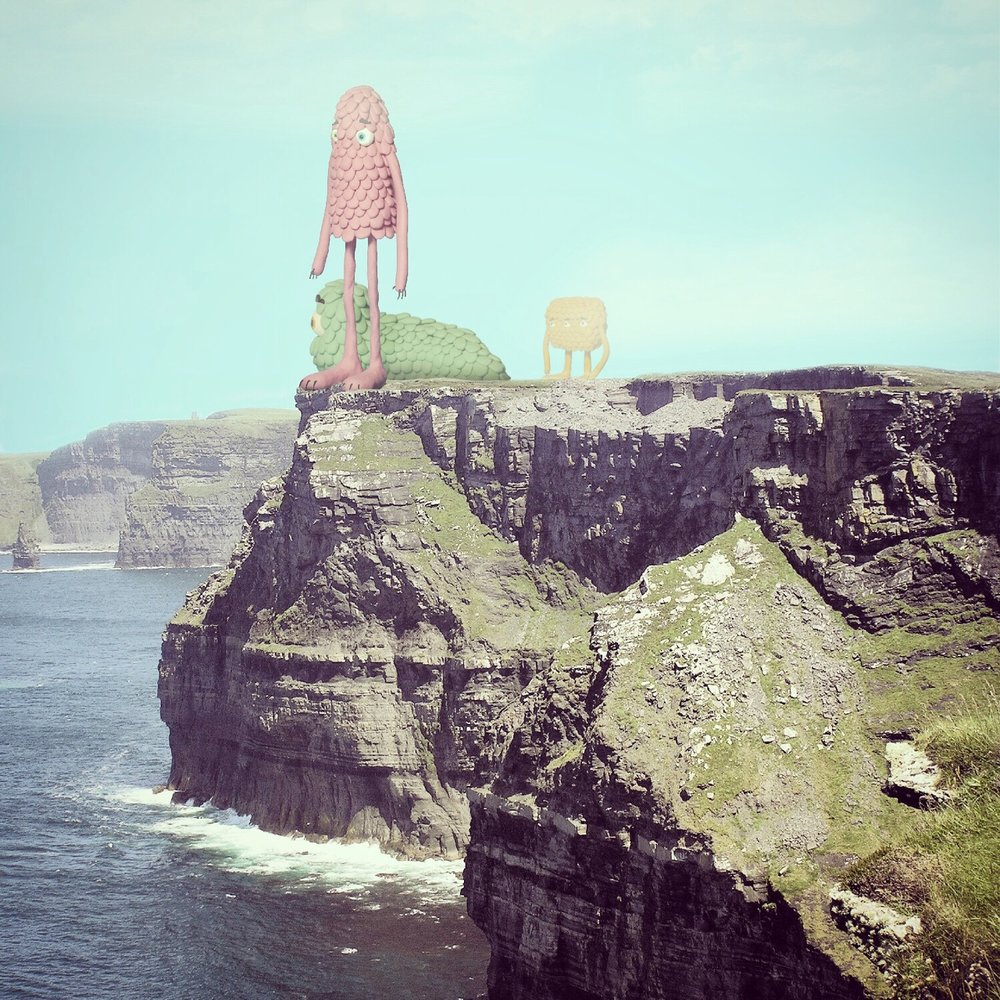 Giant creatures on the cliff edge.