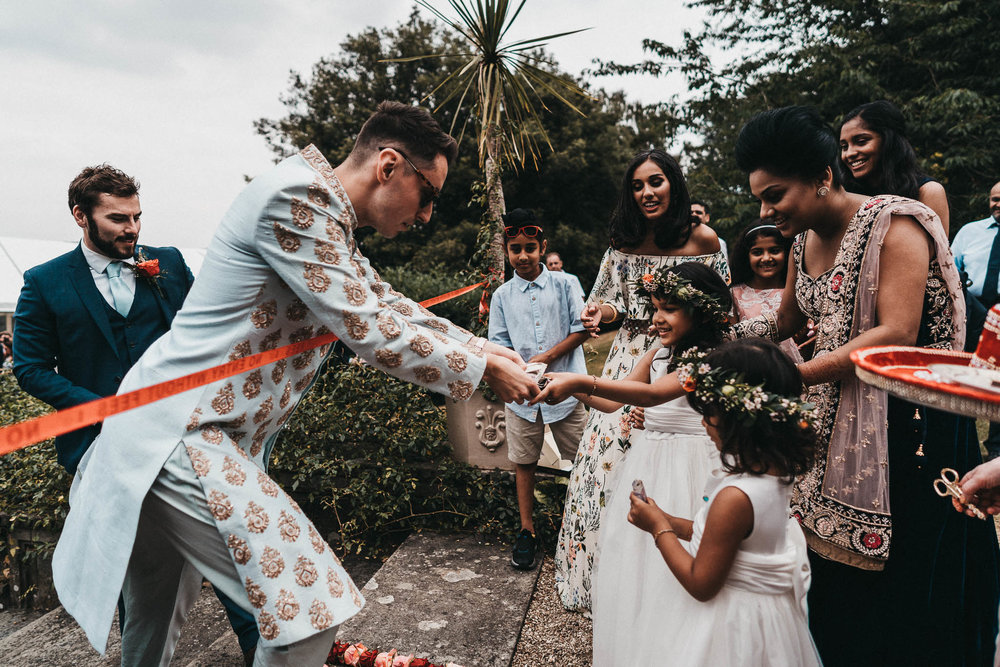 fun asian wedding photography in the cotswolds