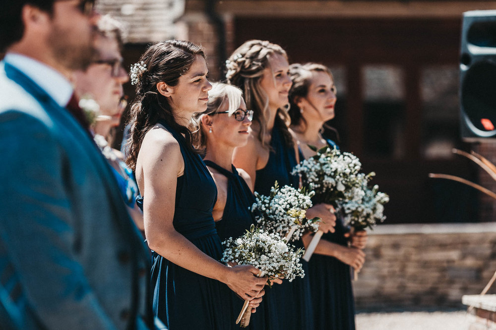 bridesmaids in navy blue dresses