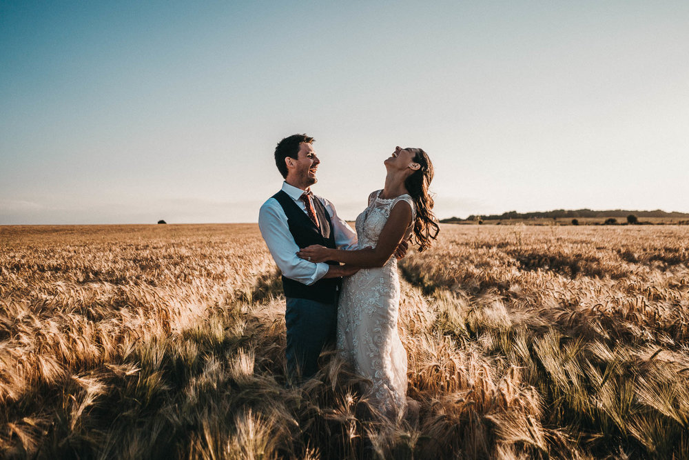 bride and groom in wheat fields