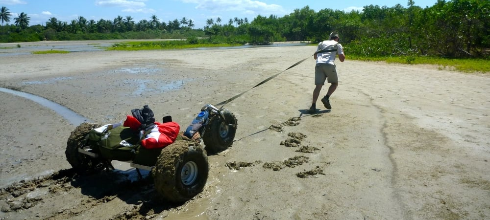 Harry dragging the buggy from the mud in Brazil kite buggy adveture