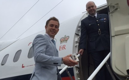 Charlie boarding royal jet with Oppo ice cream. Best British innovation showcase 2015.