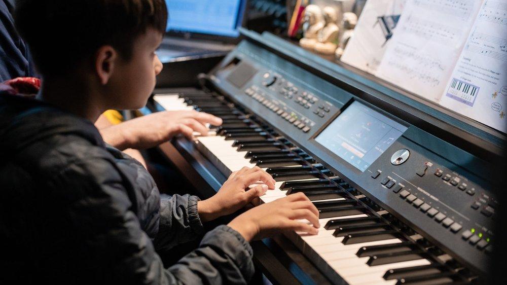 Boy 8 yrs close up piano.PNG