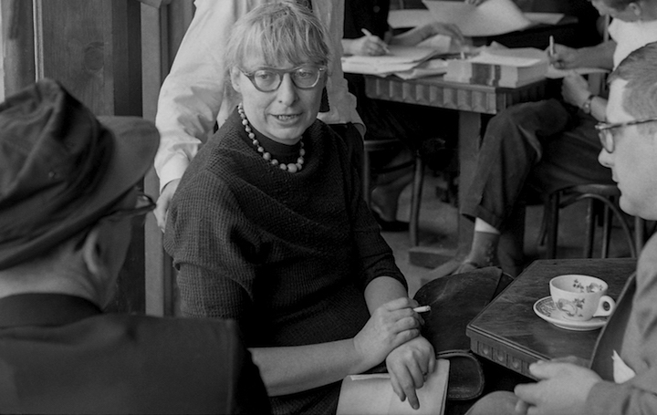 Jane Jacobs leading a planning meeting for West Village Houses in May 1963. West Village Houses was the housing project she helped to develop after preventing an urban renewal plan for the neighborhood in 1961; the forty-two subsidized walk-up apartments opened in 1974. Bob Gomel, 1963. Becoming Jane Jacobs, p. 298.