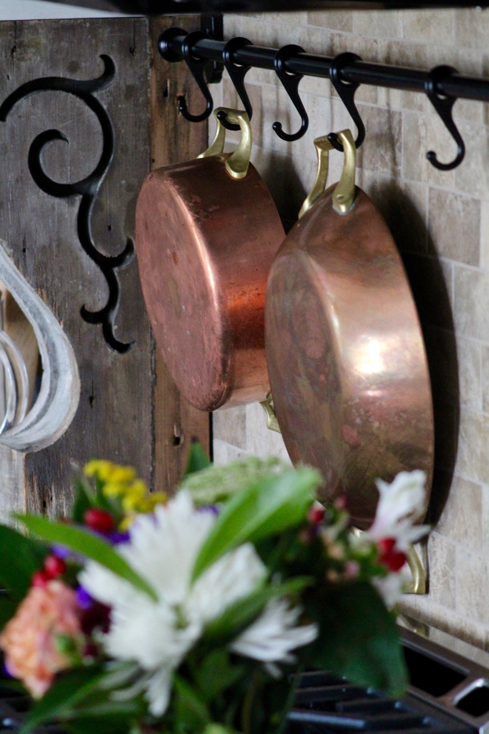 "A full set of stunning Paul Revere Copper Pots was given to us by a family friend. To say we are honored she thought enough of us to pass down such an amazing family heirloom is an understatement. They are so loved and will ALWAY hang proudly in my kitchen. Copper is ""trending"" right now, but I have plans to show these off for the rest of forever!"