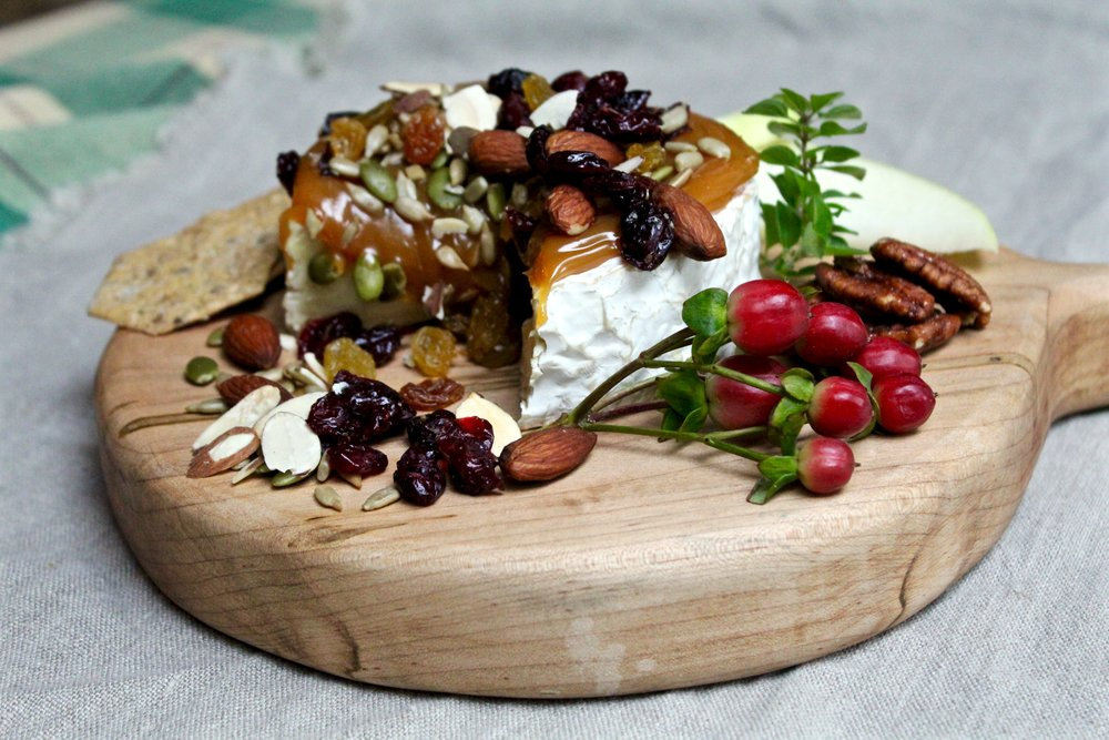 Brie is one of my favorite go-to fancy cheeses. Claire taught us how to make it even more special topped with decadent caramel, candied pecans, almonds, and other goodies. The small wheel is perfect for our round handled signature board. Perfect without being too much for this smaller board to handle.