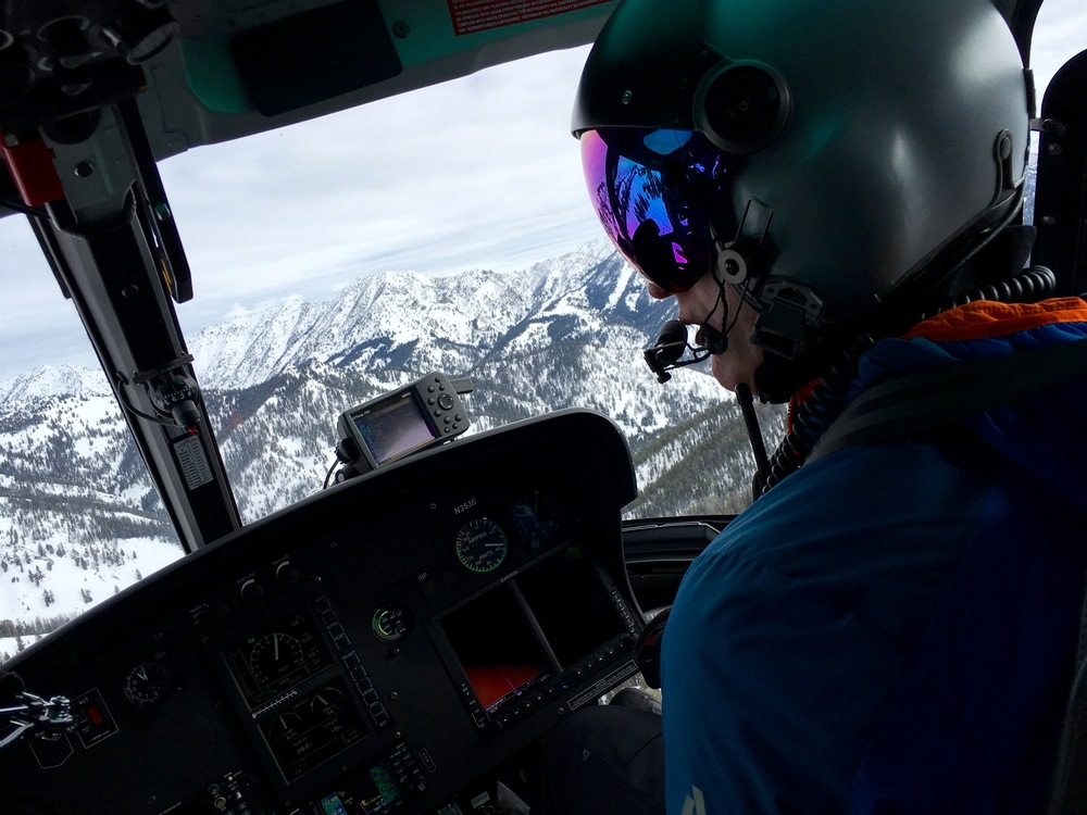 SVHS pilot Chris Templeton spots a landing zone atop an Idaho peak.