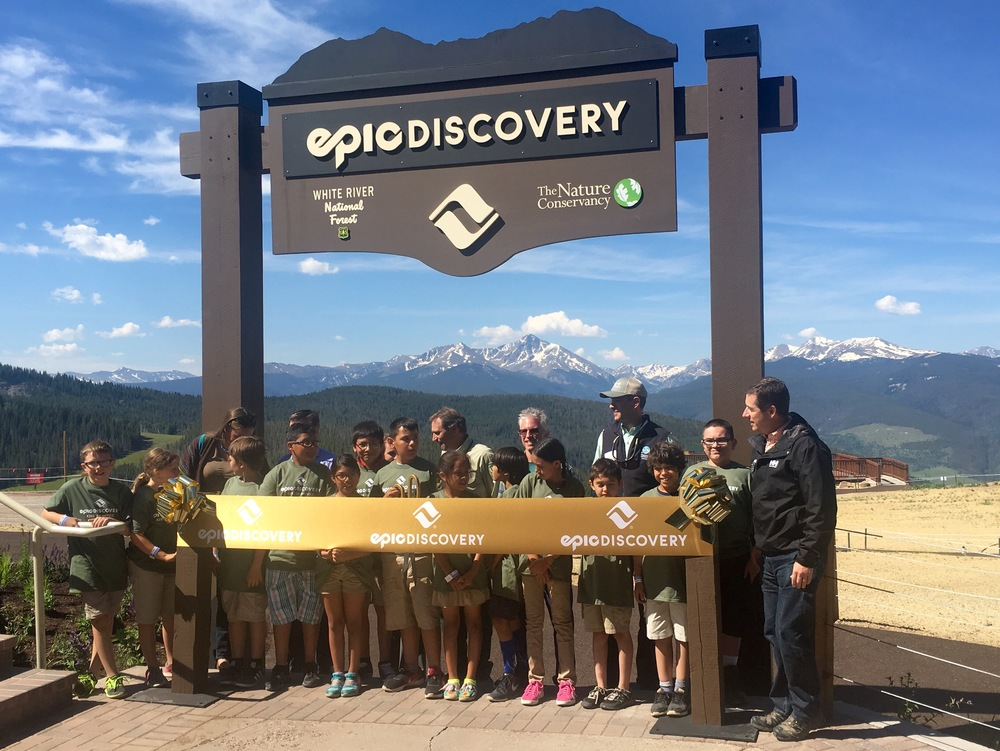 Vail Mountain COO Chris Jarnot, The Nature Conservancy's Colorado Director Carlos Fernandez, and kids from SOS Outreach cut the ribbon a the official launch of Vail Epic Discovery. (@beingalexp)