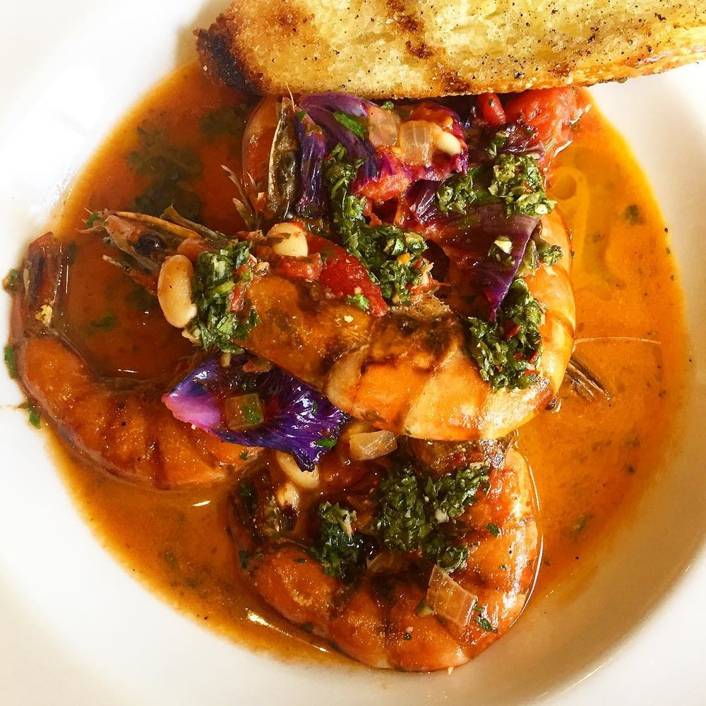 A rainbow of colors in one dish - our take on a shrimp scampi. New Caledonia shrimp with white bean and black eyed pea ragu, kale and salsa verde. #jacksonhole #jhdreaming #shrimp#seafood #foodnetwork #foodporn