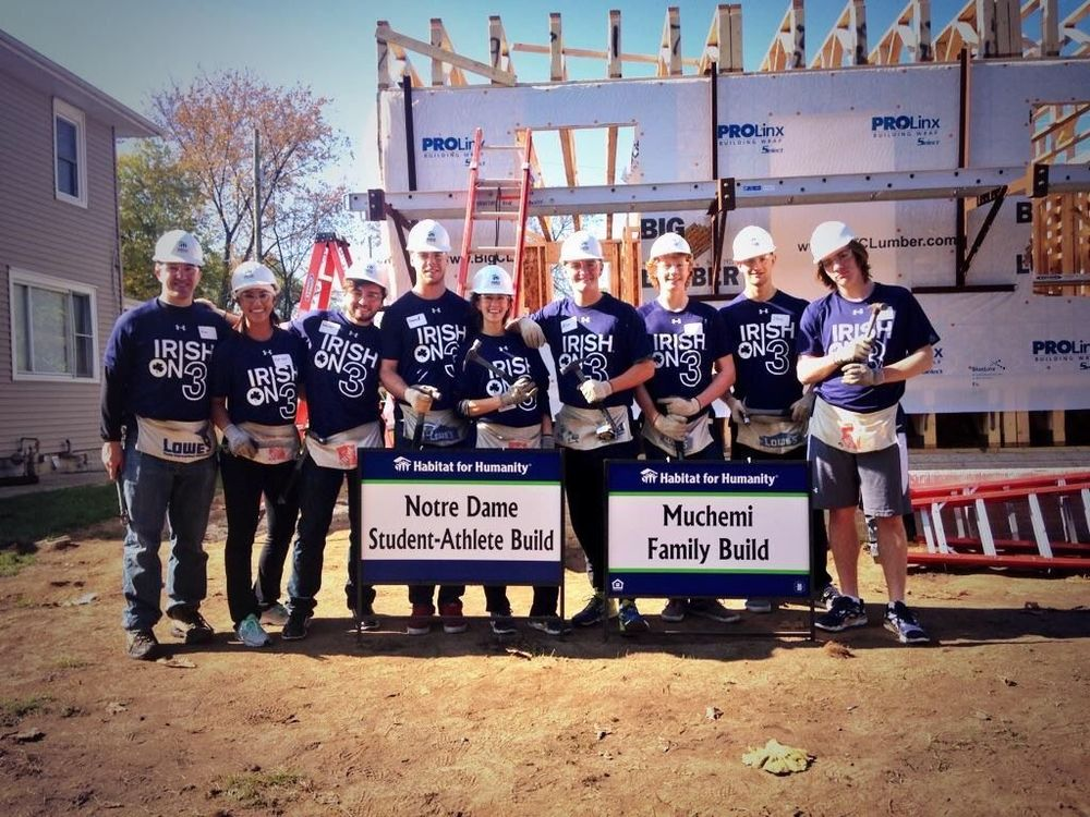 2014-15  For the 2014-2015 academic year, SAAC partnered with Habitat for Humanity of St. Joseph County to build a new home for the local Muchemi family. On the first day of the build, student-athletes built the walls and frames of the house. Habitat then transported the frame of the house to the build site, where they will be volunteering throughout the fall and spring semesters in groups of about 15.  For more photos of the SAAC Habitat for Humanity build, click