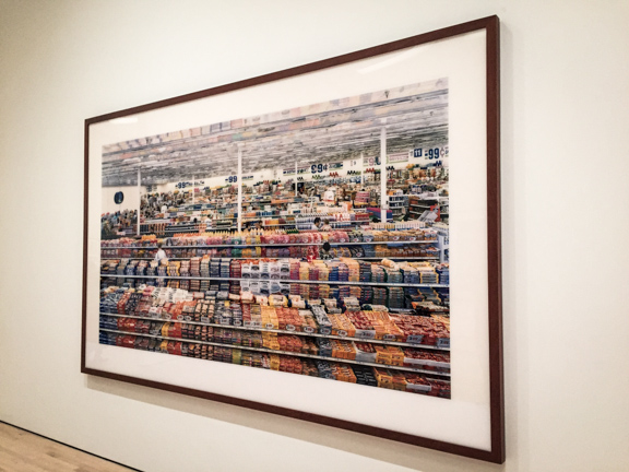 Andreas Gursky, photograph matted and framed in dark wood.