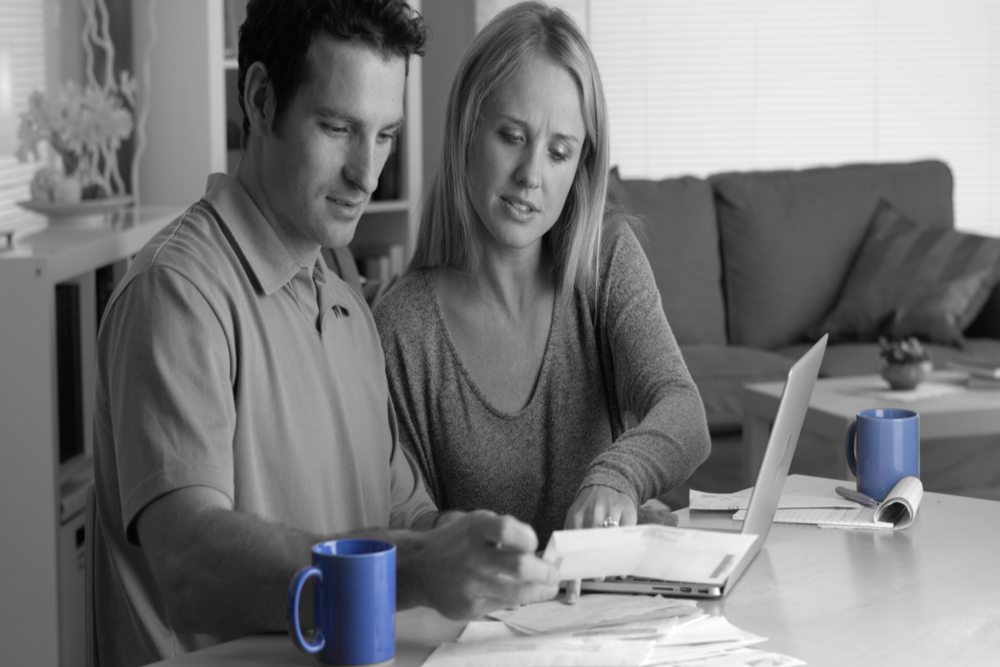 Couple Paying Bills Blue Cups - edit.png