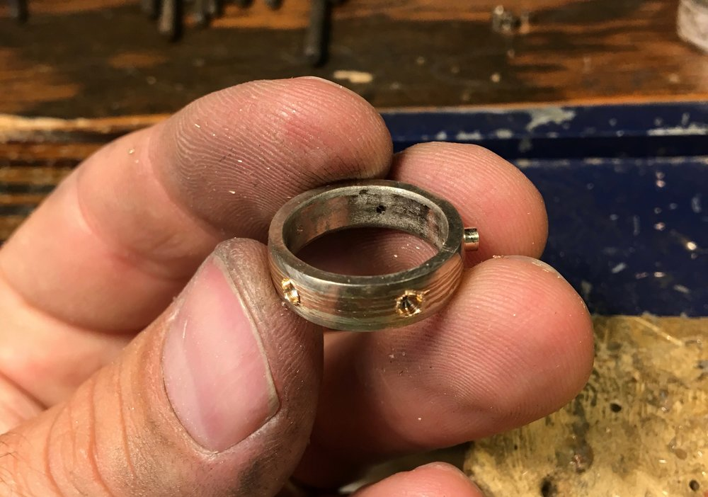 14k white gold tubing is being seated/ fitted in place, soon to become the bezels/ settings for the diamonds....