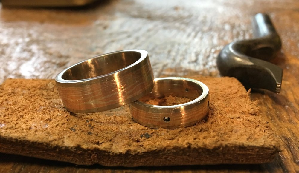 In this view the outside has been filed and sanded and is ready for polishing. You can see my DuKo stamp for hammering my name inside the rings....
