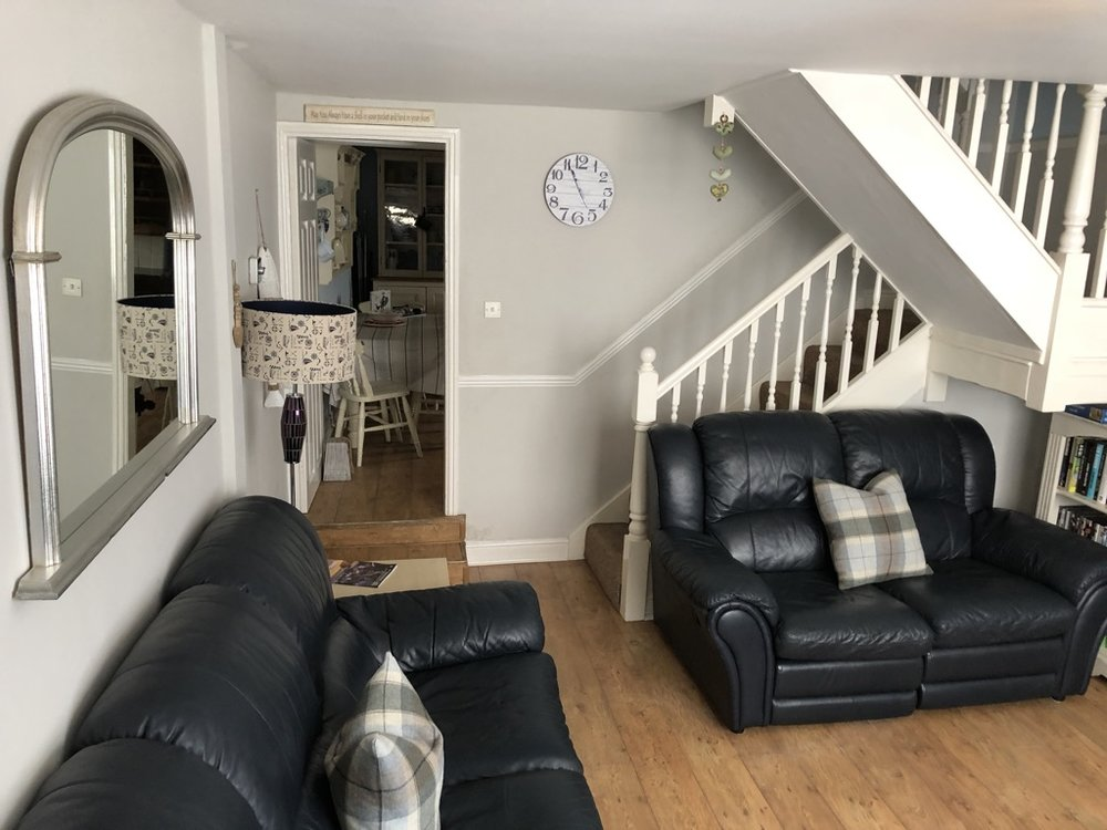 Entrance to living room, 3 Seater, 2 Seater leather sofas and chair with recliners.TV with Freesat, DVD/video player and selection of DVDs and videos are available. Coal effect electric fire place.