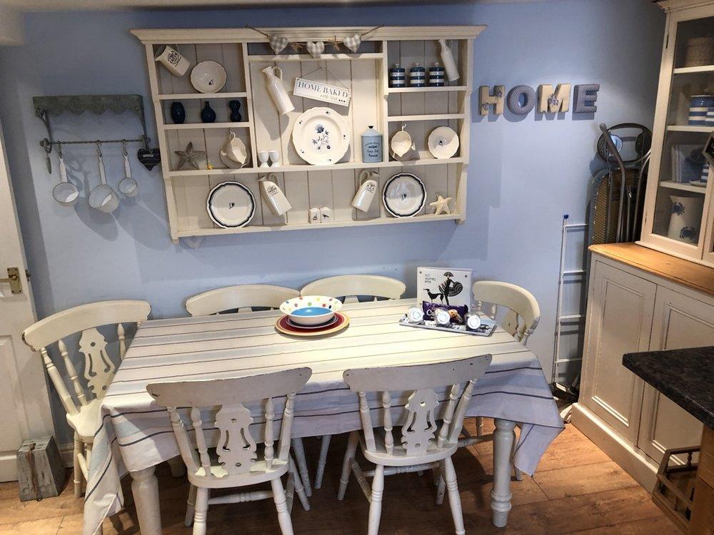 Kitchen, seating for 6, oven,electric hob, microwave,washing machine, fridge, freezer, kettle, ironing board/iron.