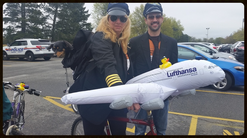Heike and Victor and pup co-pilot, flying through the route