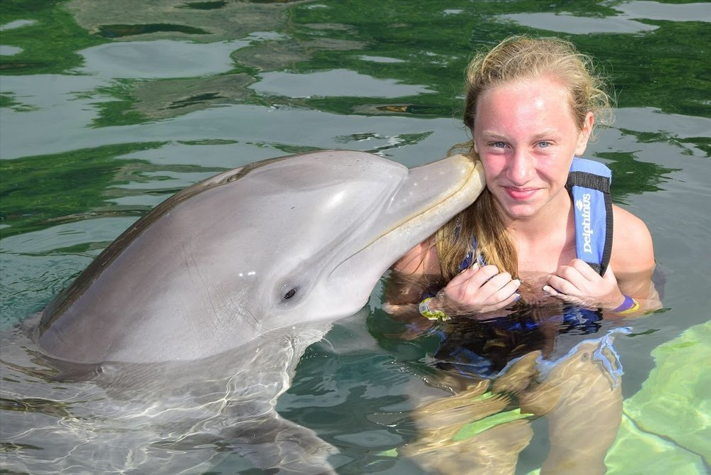 Flynn Xel Ha Dolphin Kiss.jpg