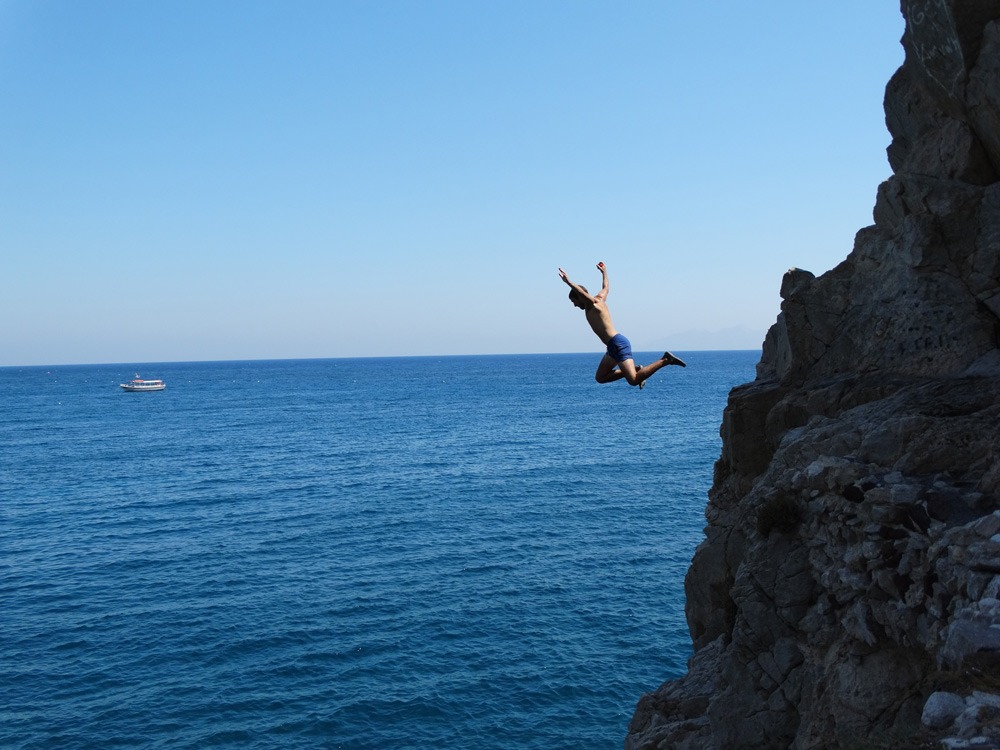 Cliff jump out of your comfort zone at Kamari Beach