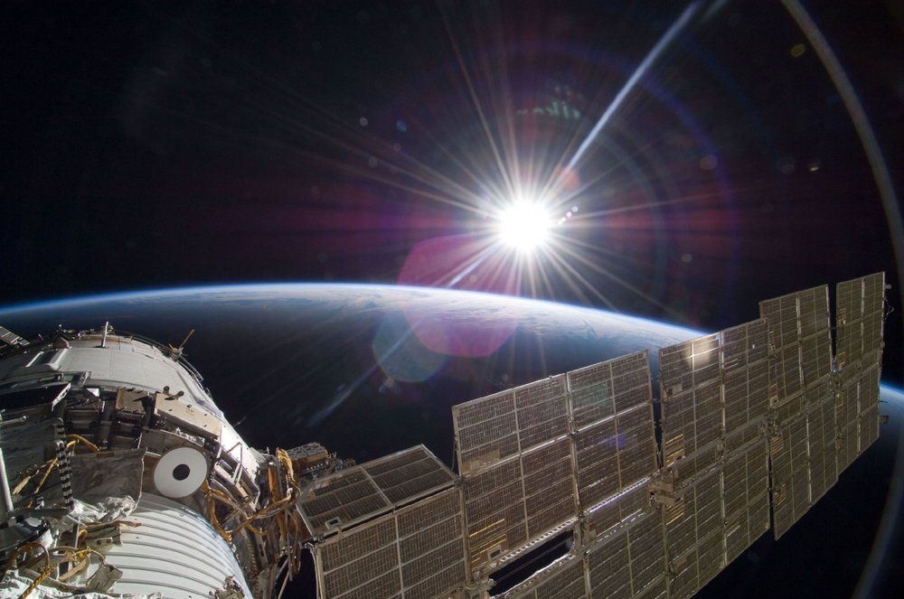 """The bright sun greets the International Space Station in this Nov. 22, 2009 scene from the Russian section of the orbital outpost, photographed by one of the STS-129 crew members."""