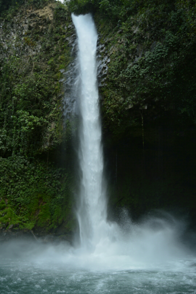 The La Fortuna waterfall emerges from dense jungle greenery, and drops some 200 feet into an emerald pool below.