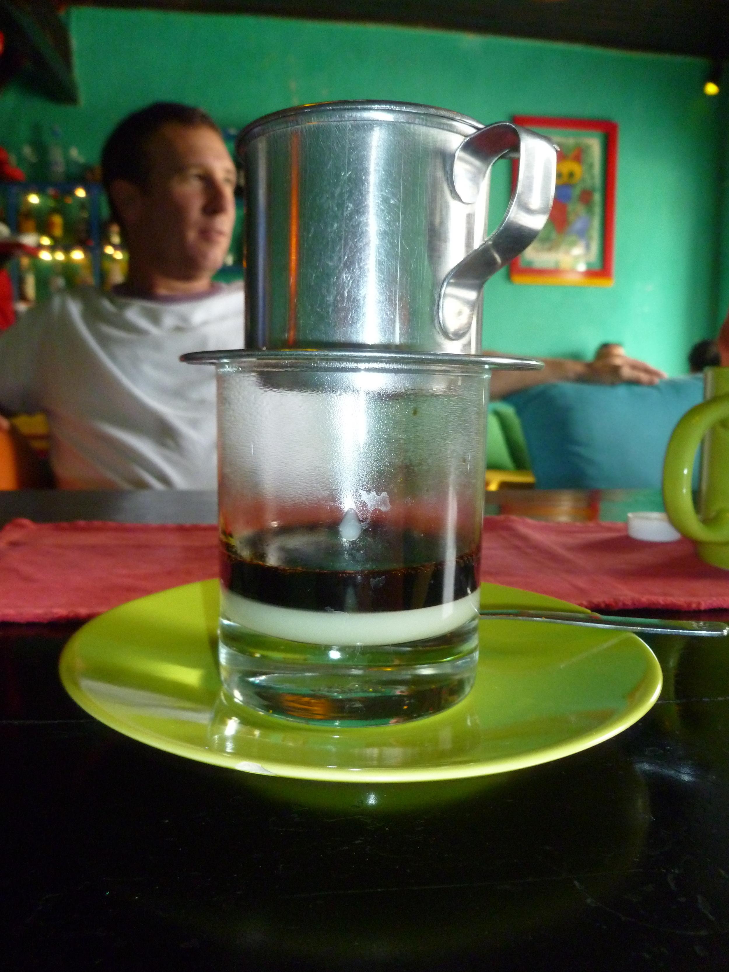 My Handsome husband enjoying a Vietnamese coffee in Hoi An, Vietnam