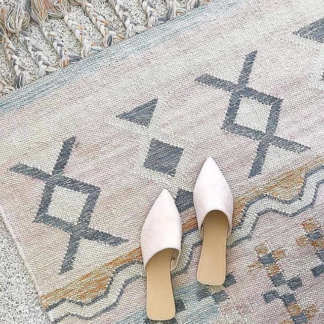 Loving this rug for Rosalee's room. World Market has rugs in sale right now! Go check it out!
